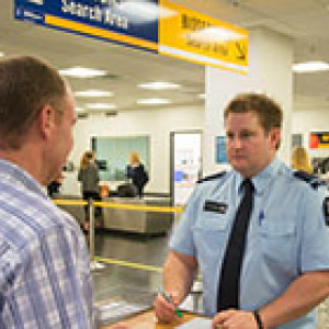biosecurity officer and passenger at Wellington airport