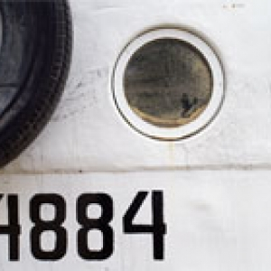 porthole and painted number 4884 on side of a ship