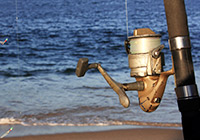 fishing rod winder against sea