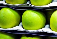 green apples sitting on a shelf
